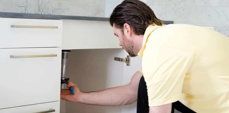 McLoughlin Plumbing Heating & Cooling technician fixing kitchen plumbing Delaware County